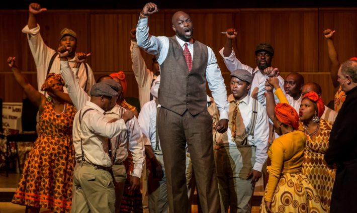 Peace R. Nzirawa as Mandela 2 and cast in Mandela Trilogy at the Royal Festival as part of Southbank Centre's Africa Utopia. Credit Victor Frankowski. (2) (1)